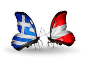 Butterflies with flags of Greece and Austria — Stock Photo
