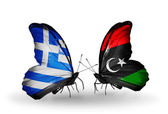 Two butterflies with flags of relations  Greece and Libya — Stock Photo