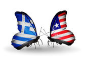 Two butterflies with flags of relations Greece and Liberia — Stock Photo
