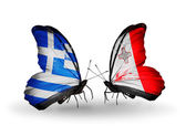 Two butterflies with flags of relations  Greece and Malta — Stock Photo