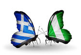 Two butterflies with flags of relations Greece and Nigeria — Stok fotoğraf