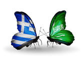Two butterflies with flags of relations  Greece and Saudi Arabia — Stock Photo
