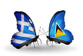 Two butterflies with flags of relations  Greece and Saint Lucia — Stock Photo