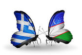 Two butterflies with flags of relations Greece and Uzbekistan — Stock Photo