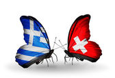 Two butterflies with flags of relations Greece and Switzerland — Stock Photo