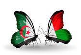 Zwei Schmetterlinge mit Flaggen der Beziehungen, Algerien und Madagaskar — Stockfoto