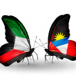 Stock Photo: Two butterflies with flags of relations Kuwait and Antiguand Barbuda