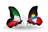 Two butterflies with flags of relations Kuwait and Antigua and Barbuda — Stock Photo