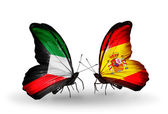 Two butterflies with flags of relations Kuwait and Spain — Stock Photo
