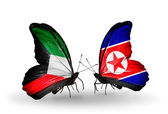 Two butterflies with flags of relations  Kuwait and North Korea — Stock Photo