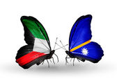 Two butterflies with flags of relations Kuwait and Nauru — Stock Photo