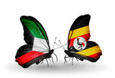 Two butterflies with flags of relations Kuwait and Uganda — Stock Photo