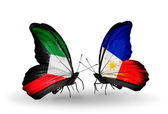 Two butterflies with flags of relations Kuwait and Philippines — Stock Photo