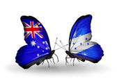 Two butterflies with flags of relations Australia and Honduras — Stock Photo
