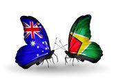 Dos mariposas con banderas de relaciones australia y guyana — Foto de Stock