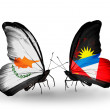 Stock Photo: Two butterflies with flags of relations Cyprus and Antiguand Barbuda