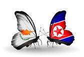Two butterflies with flags of relations Cyprus and North Korea — Stock Photo