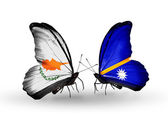 Two butterflies with flags of relations Cyprus and Nauru — Stock Photo