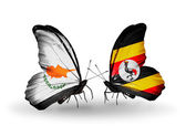 Two butterflies with flags of relations Cyprus and Uganda — Zdjęcie stockowe