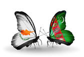 Two butterflies with flags of relations Cyprus and Turkmenistan — Zdjęcie stockowe