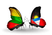 Two butterflies with flags of relations Lithuania and Antigua and Barbuda — Zdjęcie stockowe