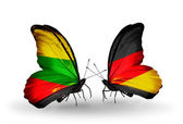Butterflies with flags of Lithuania and Germany — Stock Photo