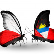 Stock Photo: Butterflies with flags of Poland and Antiguand Barbuda