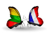 Butterflies with flags of Lithuania and France — Stock Photo