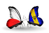 Butterflies with flags of Poland and Barbados — Stock Photo