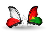 Butterflies with flags of Poland and Burkina Faso — Stock Photo