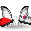 Two butterflies with flags  of  Poland and South Korea — Stock Photo #42158637