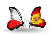 Dva motýli s vlajkami Polska a Španělska — Stock fotografie