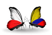 Two butterflies with flags  of Poland and Columbia — Stock Photo