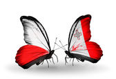 Two butterflies with flags  of Poland and Malta — Stock Photo