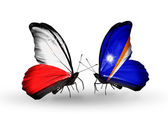 Two butterflies with flags  of Poland and Marshall islands — Stock Photo