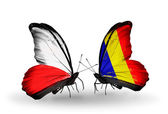 Two butterflies with flags  of Poland and Chad, Romania — Stock Photo