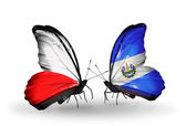 Two butterflies with flags  of Poland and Salvador — Stock Photo