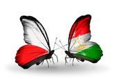 Two butterflies with flags  of  Poland and Tajikistan — Stock Photo