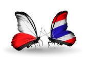 Två fjärilar med flaggor av Polen och thailand — Stockfoto