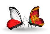 Dwa motyle z flagami Polski i sri lanka — Zdjęcie stockowe
