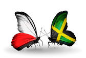 Two butterflies with flags  of Poland and Jamaica — Stock Photo