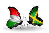 Butterflies with flags Hungary and Jamaica — Stock Photo