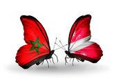 Mariposas con banderas de marruecos y letonia — Foto de Stock