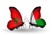 Mariposas con banderas de marruecos y madagascar — Foto de Stock