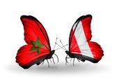 Mariposas con banderas de marruecos y perú — Foto de Stock