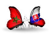 Dos mariposas con banderas de marruecos y españa — Foto de Stock