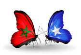 Dos mariposas con banderas de marruecos y somalia — Foto de Stock