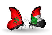 Two butterflies with flags Morocco and Sudan — Stock Photo