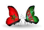 Dos mariposas con banderas de marruecos y turkmenistán — Foto de Stock