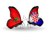 Dos mariposas con banderas de marruecos y croacia — Foto de Stock
